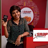 Khyati Garach uses Mswipe's Point of Sale machine at her Fitness Center